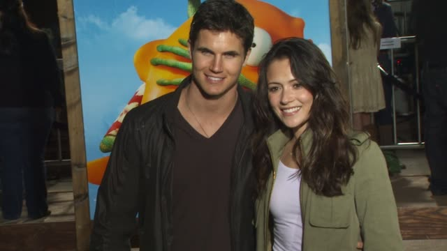 robbie amell and italia ricci at the 'rango' premiere at westwood ca - westwood stock videos & royalty-free footage