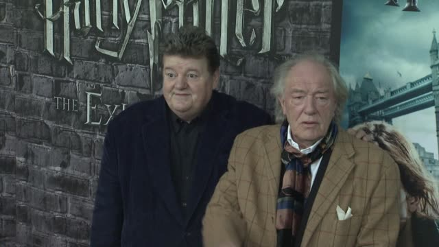 Robbie Coltrane and Sir Michael Gambon at the Launch Event for the Home Entertainment release of Harry Potter and the Deathly Hallows Part 1 at New...