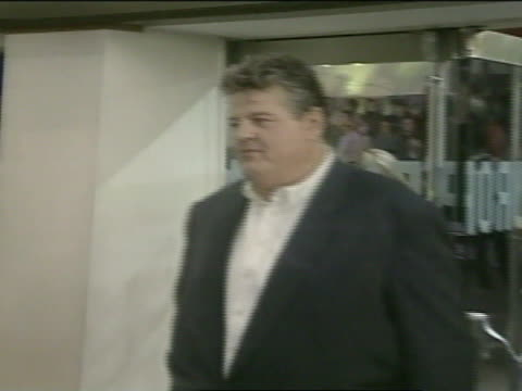 NIGHT * MS Robbie Coltrane wife Rhona Gemmell entering Odeon Theatre posing by entrance way for press photographs