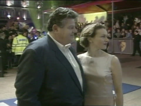 NIGHT * MS Robbie Coltrane wife Rhona Gemmell standing at Leicester Square posing for press photographs press fans BG