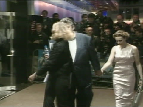 NIGHT * MS Robbie Coltrane wife Rhona Gemmell walking outside of Odeon Theatre entrance press BG FG posing for photographs