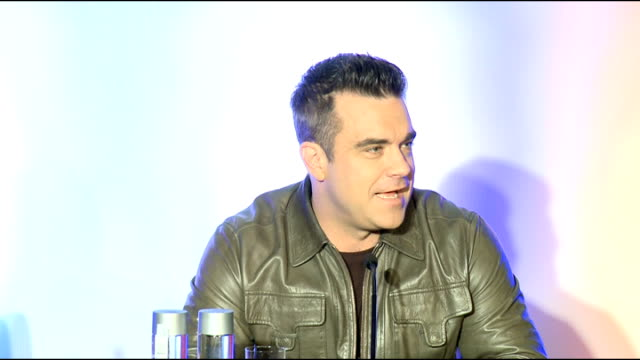 robbie williams press conference england london soho hotel int robbie williams backdrop at press conference / gvs robbie williams announced and into... - seal singer stock videos and b-roll footage