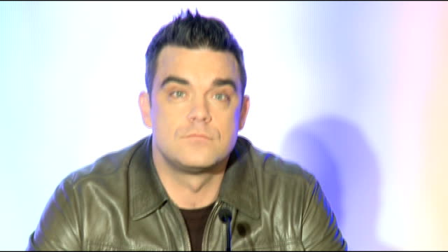 Robbie Williams press conference Robbie Williams question and answer session SOT on learning other languages on it being a legacy tour been lethargic...