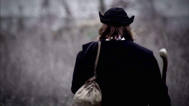 a robed man walks across a grassy field. - renaissance stock videos & royalty-free footage