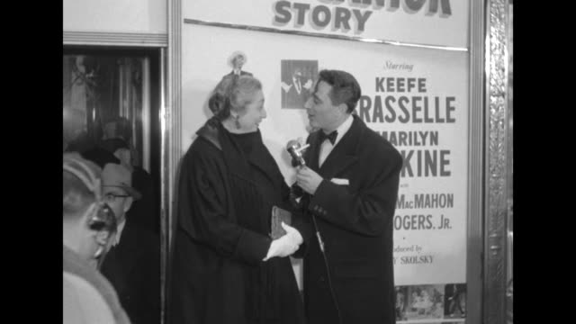 Robert Alda interviews Aline MacMahon outside the Paramount Theater at the premiere of The Eddie Cantor Story
