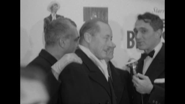 Robert Alda interviews Danton Walker and Bob Weitman outside the Paramount Theater at the premiere of The Eddie Cantor Story