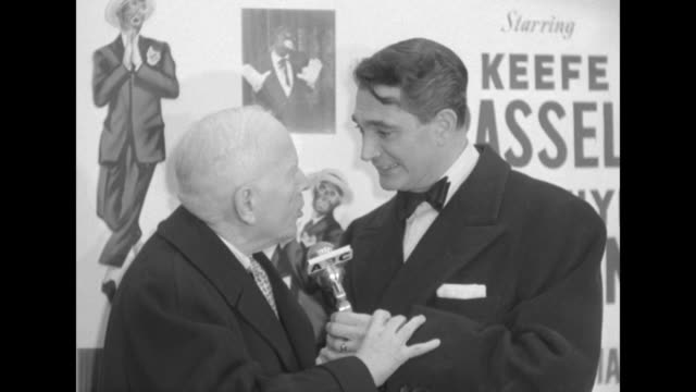 Robert Alda interviews Harry Hershfield outside the Paramount Theater at the premiere of The Eddie Cantor Story