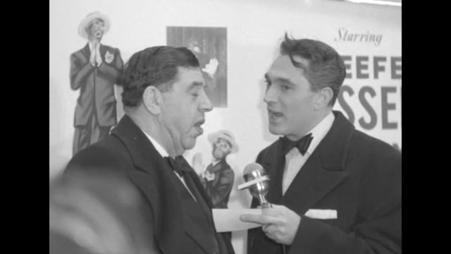Robert Alda interviews Joseph Lazarus outside the Paramount Theater at the premiere of The Eddie Cantor Story