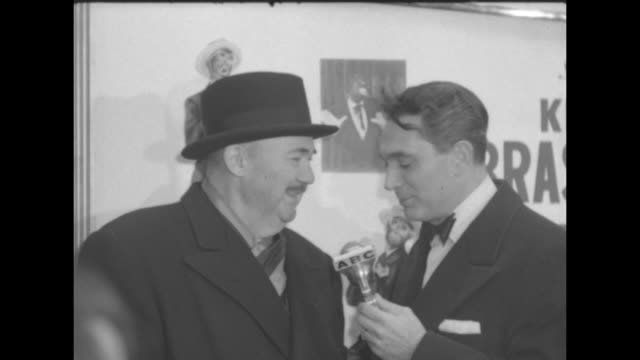 Robert Alda interviews the bandleader Paul Whiteman note blackface images in poster on the wall behind them
