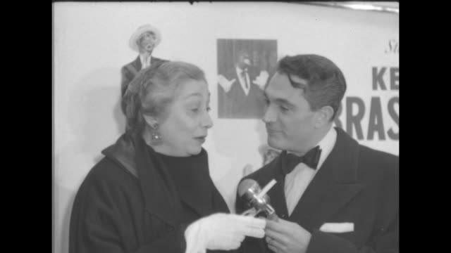 VS Robert Alda interviews the costar of the movie Aline MacMahon note blackface images in poster on the wall behind them