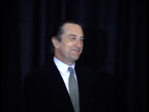 robert de niro enters the stage and smiles for photographs - friars roast 1993 stock videos and b-roll footage