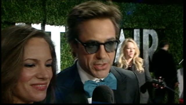 Robert Downey Jr and wife Susan Downey interviewed as arrive for Vanity Fair Oscars party SOT On Bigelow winning Best Director award Ed Asner...
