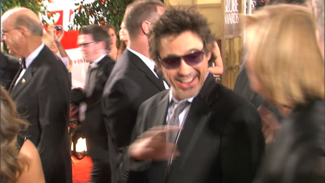 MCU Robert Downey Jr laughing and talking w/ Emma Thompson pan with Tom Cruise as he walks down red carpet