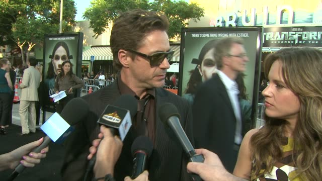 robert downey jr. on doing iron man the second time around at the 'orphan' premiere at westwood, los angeles ca. - premiere event stock videos & royalty-free footage