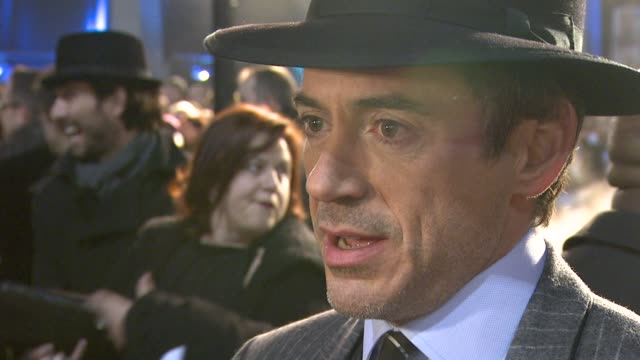 robert downey jr on making his own martial arts for the film on the fight scenes at the sherlock holmes uk premiere at london england - sherlock holmes stock videos & royalty-free footage