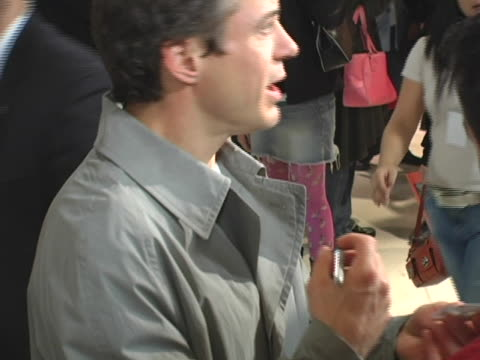 Robert Downey Jr signs autographs for the press at the Robert Downey Jrs The Futurist CD Release at Virgin Megastore in Hollywood in Hollywood...