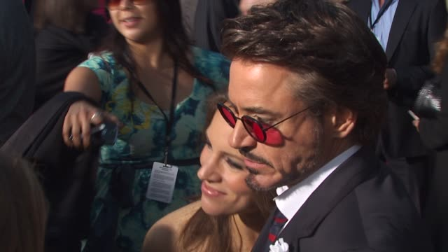 robert downey jr susan downey at the 'iron man 2' premiere at hollywood ca - boutonniere stock videos and b-roll footage