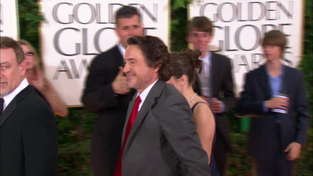 Robert Downey Jr w/ wife Susan Downey walking down the red carpet at the Beverly Hilton Hotel