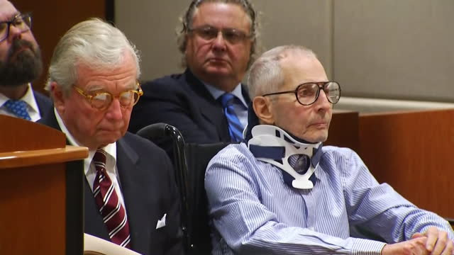 robert durst enters a courtroom in los angeles california during his arraignment on murder charges for the alleged killing of susan berman - crime or recreational drug or prison or legal trial stock-videos und b-roll-filmmaterial