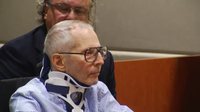 robert durst enters courtroom in wheelchair for arraignment against charges of murder in the death of susan berman - crime or recreational drug or prison or legal trial stock-videos und b-roll-filmmaterial