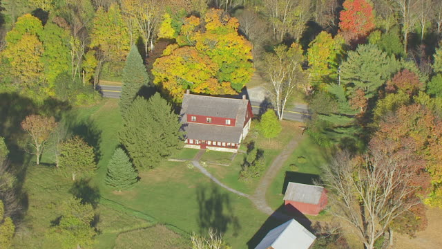 WS AERIAL POV Robert Frost Museum with tree area / Shaftsbury, Vermont, United States