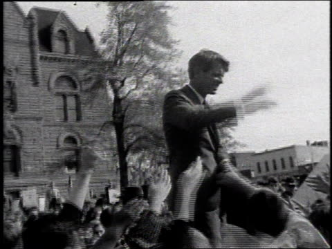 Robert Kennedy greeting cheering supporters ans shaking hands / United States