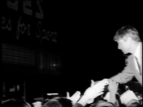 Robert Kennedy shaking hands with supporters / United States
