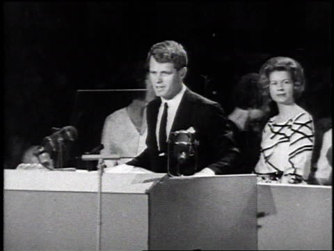 vídeos y material grabado en eventos de stock de robert kennedy standing at podium at democratic convention while campaigning for senate seat / new york city new york united states - senador