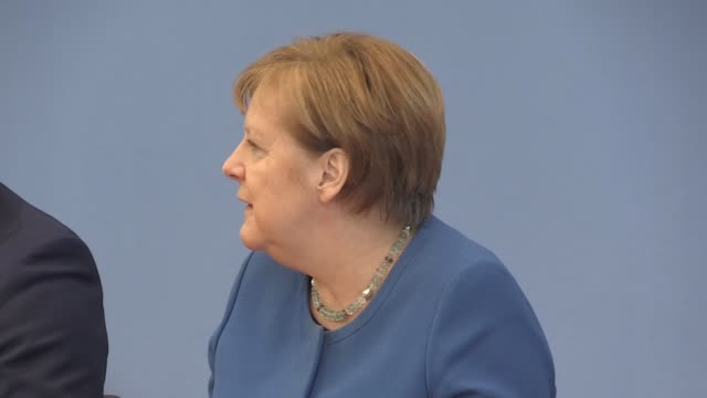 robert koch institute president lothar wieler german health minister jens spahn and german chancellor angela merkel hold a press conference on... - angela merkel stock videos & royalty-free footage