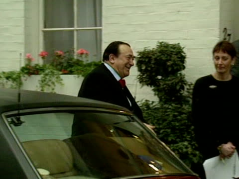 robert maxwell arrives at a building and greets some other guests - robert maxwell stock videos and b-roll footage