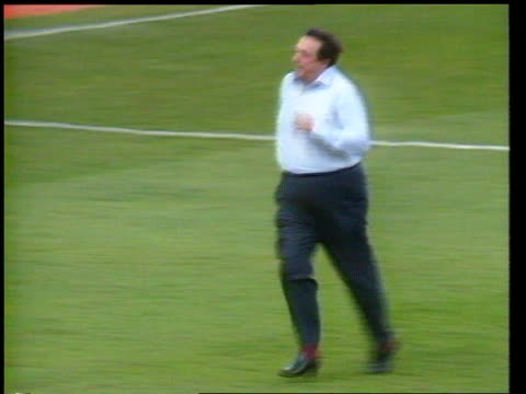 robert maxwell dead ext oxford ms robert maxwell running onto football pitch pan rl tx tms oxford utd team along with trophy itn - robert maxwell stock videos and b-roll footage
