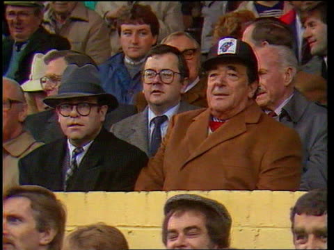 Robert Maxwell Dead Watford MS Maxwell sitting next to Elton John TX 211187 FC watching football match ITN