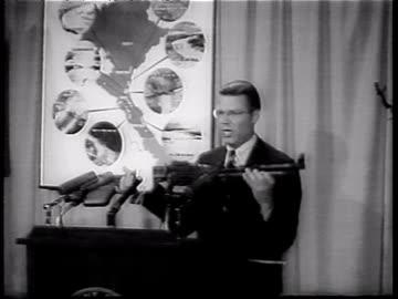 robert mcnamara displaying and holding red chinese machine gun and talking at podium , then using pointer on map during speech about vietnam war.... - 1965 stock videos & royalty-free footage