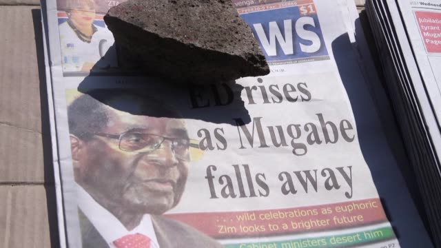 robert mugabe resigned as zimbabwe's president on tuesday finally swept from power as his 37 year reign of autocratic control and brutality crumbled... - zimbabwe stock videos & royalty-free footage