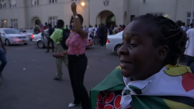 Robert Mugabe resigns as President of Zimbabwe after 37 years EXT People celebrating in street Vox pop Various shots people celebrating in street...