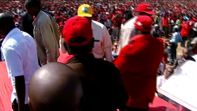 robert mugabe tells his critics to 'go hang' in first speech since re-election; 29.7.2013 / t29071331 morgan tsvangirai waving to crowds as onto... - political rally stock videos & royalty-free footage