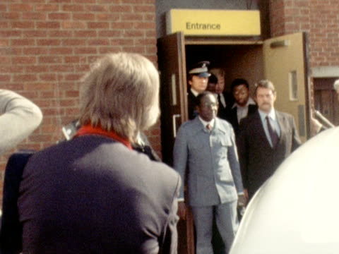 robert mugabe the leader of the patriotic front walks out of a building and poses for photographs during his visit to london for talks on the... - 1979 stock videos & royalty-free footage