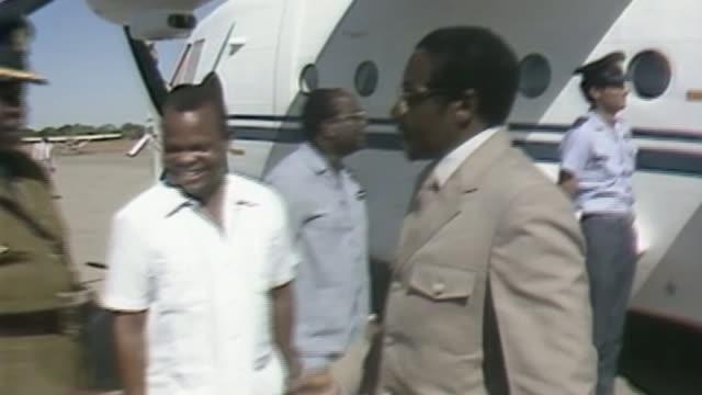 Robert Mugabe under house arrest after military take control AS150484002 / TX Robert Mugabe off plane and greeted and along Mugabe along past...