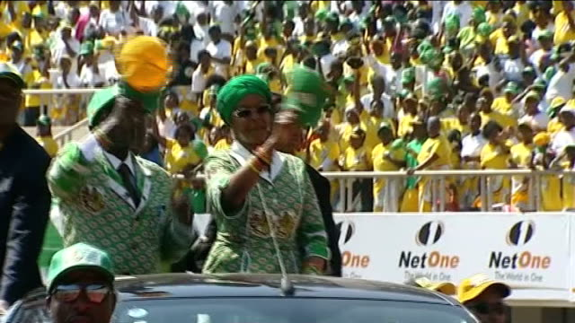 robert mugabe wins presidential election / allegations of vote rigging lib ext robert mugabe and wife grace along in open top car at his final... - anmut stock-videos und b-roll-filmmaterial