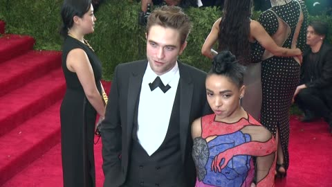 """robert pattinson and fka twigs at """"china: through the looking glass"""" costume institute benefit gala - arrivals at metropolitan museum of art on may... - cutaway video transition stock videos & royalty-free footage"""