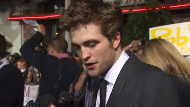 robert pattinson on his reaction to stephanie meyer's saying she's over vampires, who/what would make him scream. at the 'the twilight saga: new... - twilight stock videos & royalty-free footage