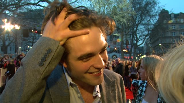 robert pattinson on how he's just arrived from work, freaked out in the car, and then just deals with it, on how premieres have become the norm in a... - big hair stock videos & royalty-free footage