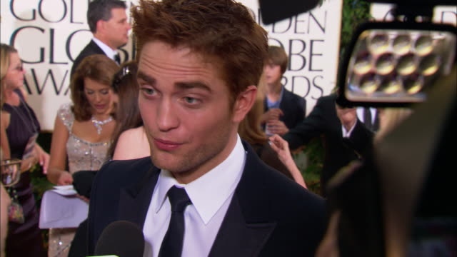robert pattinson talking to reporter on the red carpet at the beverly hilton hotel: thomas jane recording w/ his cell phone in bg - the beverly hilton hotel stock videos & royalty-free footage