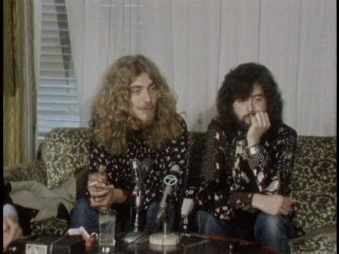 robert plant says he hopes fans are as exhausted as he and his band led zeppelin are after a concert, during a press conference alongside jimmy page... - ポピュラーミュージックツアー点の映像素材/bロール