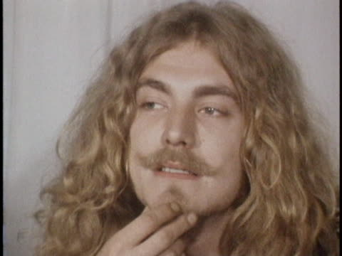 robert plant strokes goatee during a press conference alongside jimmy page before a 1970 led zeppelin concert at madison square garden - goatee stock videos & royalty-free footage