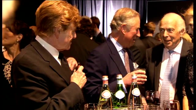 robert redford host premiere of film about environmental work of prince charles; england: london: int prince charles standing with hollywood star... - ロバート・レッドフォード点の映像素材/bロール