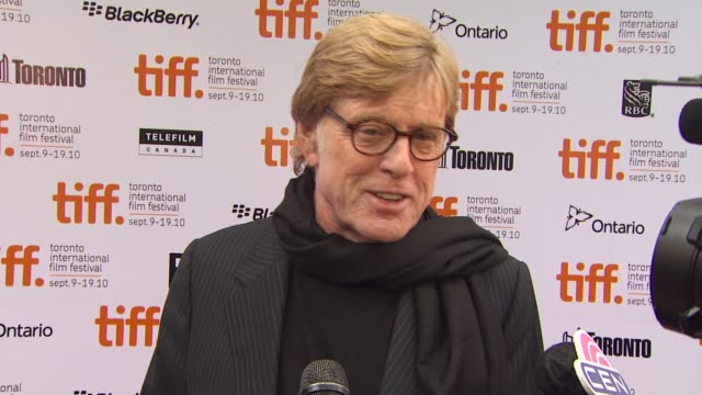 vídeos de stock e filmes b-roll de robert redford on being at tiff his thoughts on people tying the premiere of this film to the 9/11 anniversary - robert redford