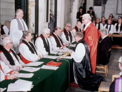 robert runcie confirmed as archbishop of canterbury; england: london: st paul's: int the right reverend robert runcie kneeling at table as recites... - robert runcie stock videos & royalty-free footage