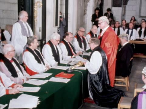 robert runcie confirmed as archbishop of canterbury; england: london: st paul's: int the right reverend robert runcie kneeling at table as recites... - robert runcie stock videos & royalty-free footage