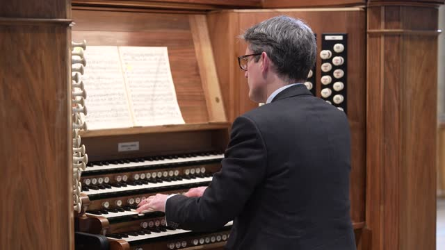 robert sharpe, director of music at york minster plays the grand organ in the cathedral's nave on march 5, 2021 in york, england. the playing comes... - spirituality stock videos & royalty-free footage